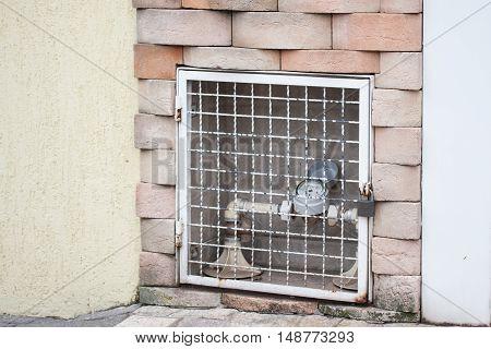 Water supply meter locked inside wall gate