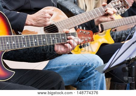 Guitar players side by side during music festival