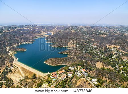 LOS ANGELES, USA - MAY 27, 2015: Aerial view of the Stone Canyon Reservoir in Bel Air. There are some estates built next to the lake.