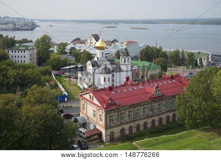 NIZHNY NOVGOROD, RUSSIA - AUGUST 27, 2015: View of the Church of mother of God of Kazan on the background of the Volga river. Historical landmark of the city Nizhny Novgorod