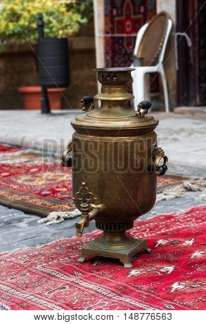 Ancient samovar. The old copper samovar with medals
