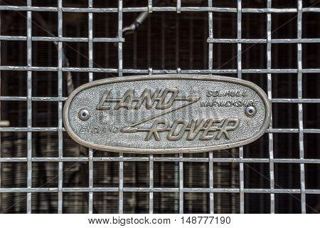KIEV UKRAINE - April 26 2015: The Retro OldCarFest in Kiev. Retro logo Land Rover closeup on a radiator.