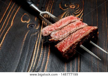 Roasted organic shin of beef meat on wooden background