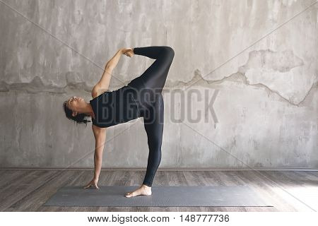 Woman Practicing Yoga In Various Poses