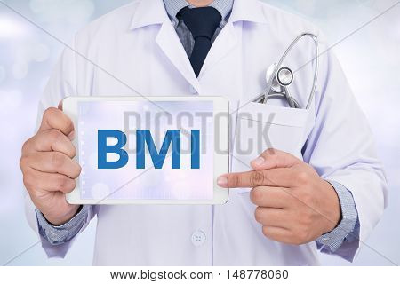 Doctor holding a tablet pc BMI doctor work to touch hand