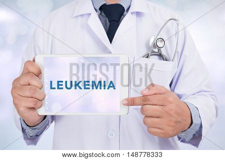 LEUKEMIA CONCEPT Doctor holding digital tablet doctor work to touch hand