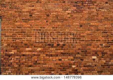 Old red brick wall building exterior background
