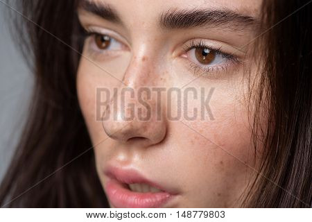 skincare and beauty concept, face a calm brunette looking left