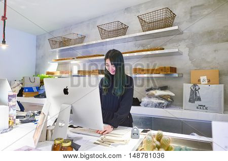 HONG KONG - CIRCA JANUARY, 2016: indoor portrait of seller at Initial store in Hong Kong. Clothing brand Initial has few stores in Hong Kong.