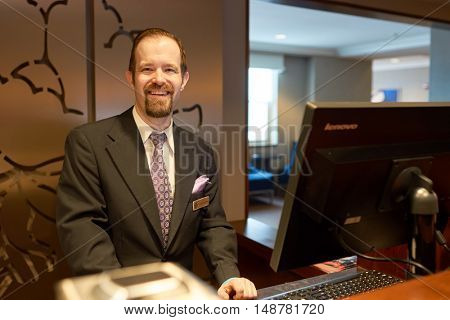 CHICAGO, IL - CIRCA MARCH, 2016: indoor portrait of a man in the Hilton Chicago. The Hilton Chicago is a large centrally-located luxury hotel in Chicago, Illinois, United States.