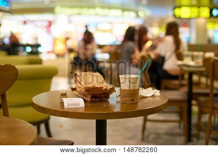 SINGAPORE- SEPTEMBER 12, 2016: Starbacks at Changi Airport in Singapore. Starbucks Corporation is an American coffee company and coffeehouse chain.