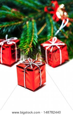 Christmas card with fir tree and red gift boxes isolated on white background. Happy New Year and Christmas