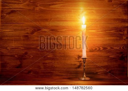 Burning Old Candle With Vintage Brass Candlestick On Wooden Background, Natural Light, Close Up