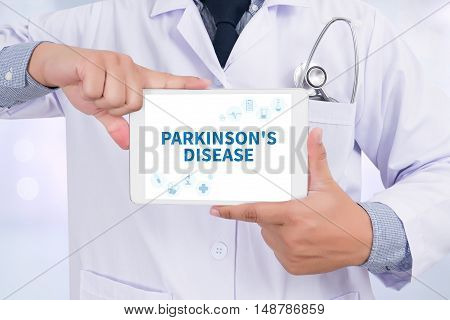 PARKINSON'S DISEASE Doctor holding digital tablet doctors work hard