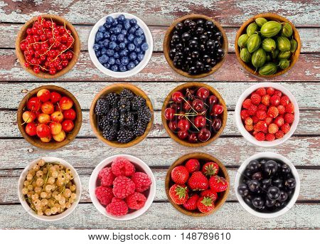 Collage of different fruits and berries isolated on white. Strawberries, currants, cherries, raspberries, gooseberries and bilberries.