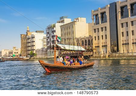 Dubai, United Arab Emirates - May 3, 2013: a traditional Abra ferry along Dubai Creek. The Creek divides the city into two main sections: Deira and Bur Dubai, a historic district in Dubai.