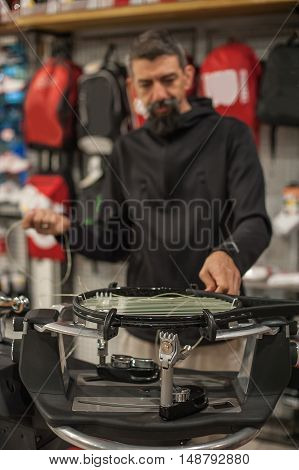 Tennis Stringer Doing Racket Stringing