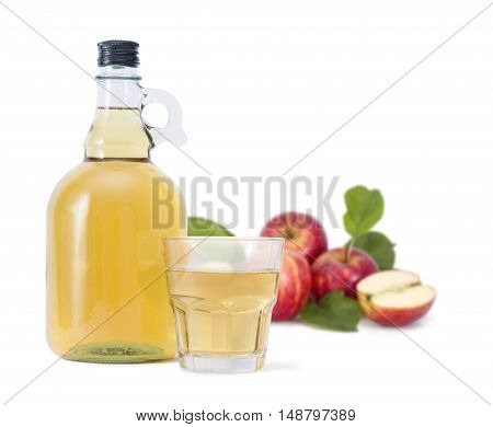 Cider and red apples with green leaves on white background