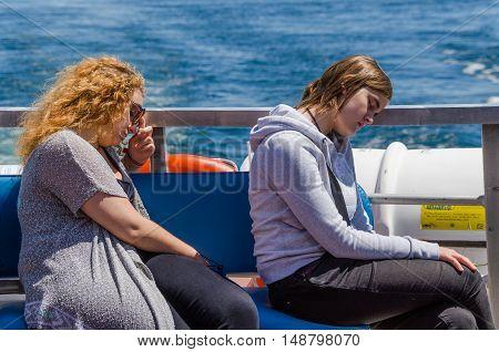 Oxnard, USA - July 24, 2014: Two women sleeping on boat in ocean