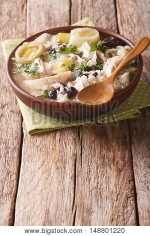 Festive Scottish Chicken Soup With Leeks And Prunes Close Up On The Table. Vertical
