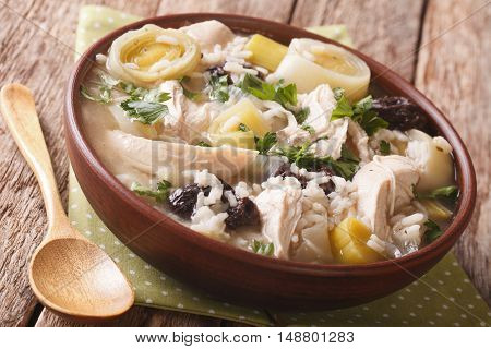 Scottish Cock-a-leekie Soup With Leeks And Prunes Close Up In A Bowl. Horizontal
