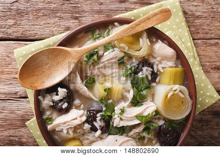 Tasty Scottish Chicken Soup With Leeks And Prunes Close Up In A Bowl. Horizontal Top View
