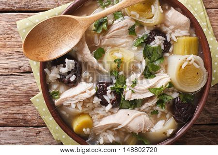 Scottish Cock-a-leekie Soup With Leeks And Prunes Close Up In A Bowl. Horizontal Top View