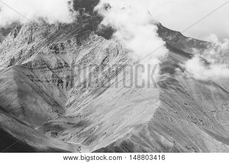 Close-up Of Mountain Ridge Over Cloud And Fog In Leh, India- In Black And White