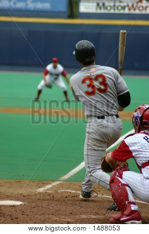 Batter Swinging And Missing