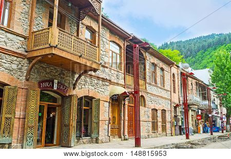 BORJOMI GEORGIA - MAY 26 2016: The tourist street with the renovated stone houses with souvenir stalls cafes of local cuisine wine shops on May 26 in Borjomi.