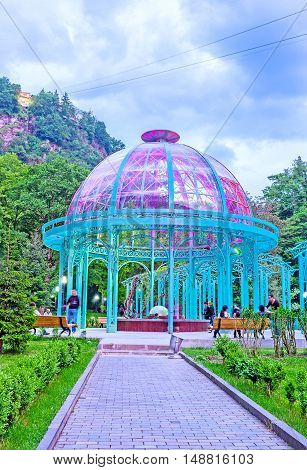 BORJOMI GEORGIA - MAY 27 2016: The colorful illumination of mineral water pavilion in park on May 27 in Borjomi.