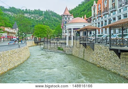 BORJOMI GEORGIA - MAY 26 2016: The luxury Crowne Plaza Hotel Complex on the bank of Borjomula river in heart of the famous spa resort located in Borjomi-Kharagauli National Park on May 26 in Borjomi.