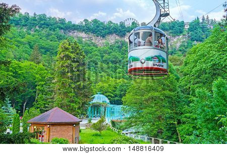 BORJOMI GEORGIA - MAY 27 2016: One of the favorite tourist attractions in resort is the cable car ride over the Mineral Water Park and Borjomi Gorge on May 27 in Borjomi.
