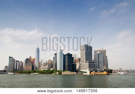 NEW YORK USA - JUNE 10 2015: Manhattan Skyline view with Staten Island Ferry Whitehall Terminal over Hudson River