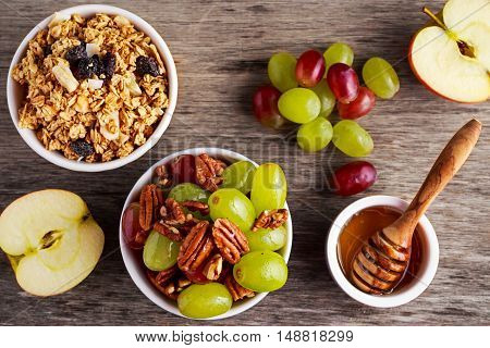breakfast prep with toasted oat clusters, juicy raisins, banana and pineapple chunks with grapes and pecan nut