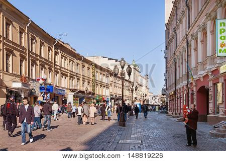 MOSCOW, RUSSIA - March 25, 2007. People walking down the famous Arbat street in the historical center of Moscow. Old fashioned street with small souvenir shops and cafe for tourists.