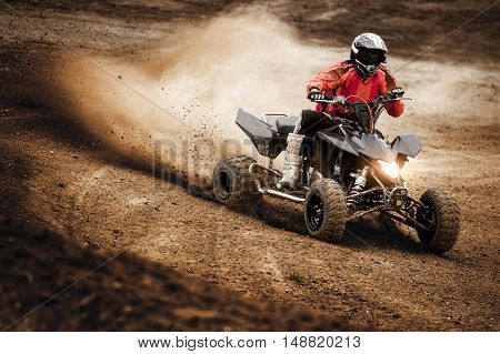 ATV Quadbike Rider in the action on dirty track