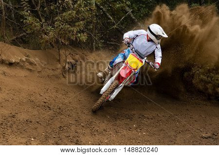 Motosport rider driving in the motocross race