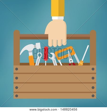 Hand with toolbox on the blue background.