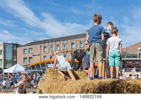EMMELOORD THE NETHERLANDS - SEP 10: Kids playing at hay bales on an agricultural potato festival on September 10 2016 in Emmeloord capitial city of Noordoostpolder the Netherlands
