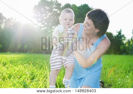 Portrait of Caucasian Mother with Her Little Son Spending Time Together Outdoors in Park.Horizontal Image Composition
