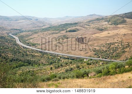 Inland landscape of inner Sicily with motorway in summer day, Sicily island