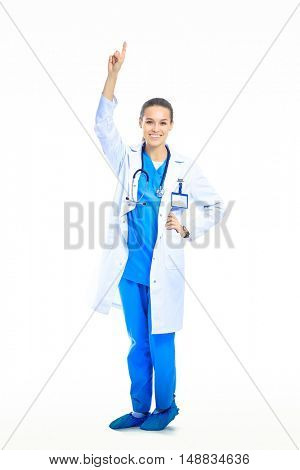 A portrait of a female doctor pointing, isolated on white background