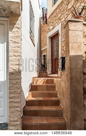 Stairs between traditional greek houses at narrow street of Sitia town on Crete island, Greece
