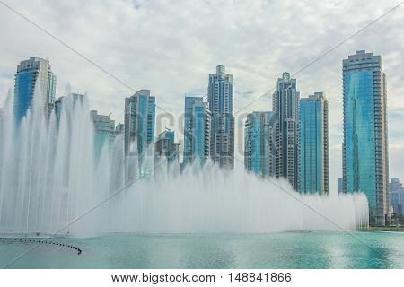 Dubai Dancing Fountain show. The Dubai Fountain, the world largest choreographed fountain on Burj Khalifa Lake, performs to the beat of the selected music at twilight.