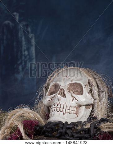 Grim reaper skull in a halloween background
