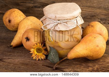 ripe pear on wood pears compote on rustic background