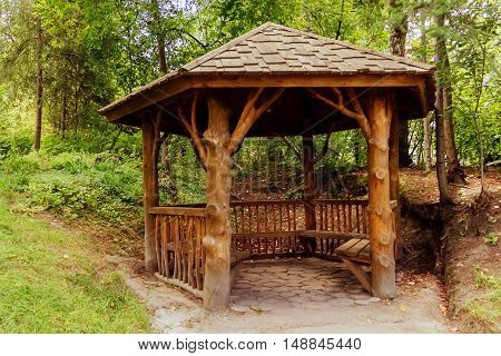 empty wooden summer house in a garden.