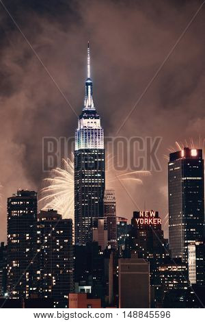 NEW YORK CITY - JUL 4: Empire State Building with fireworks on July 4, 2015 in Manhattan, New York City. With population of 8.4M, it is the most populous city in the United States.