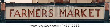 SEATTLE, WA - AUG 14: Farmer's Market sign in downtown on August 14, 2015 in Seattle. Seattle is the largest city in both the State of Washington and the Pacific Northwest region of North America